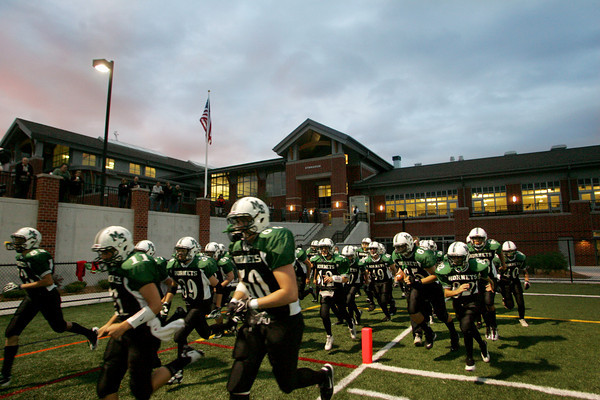 Manchester: The MAnchester Essex hornets take the field to play their first game under the lights at the new Hyland Field in front Manchester Essex Regional High School Friday night. Mary Muckenhoupt/Gloucester Daily
