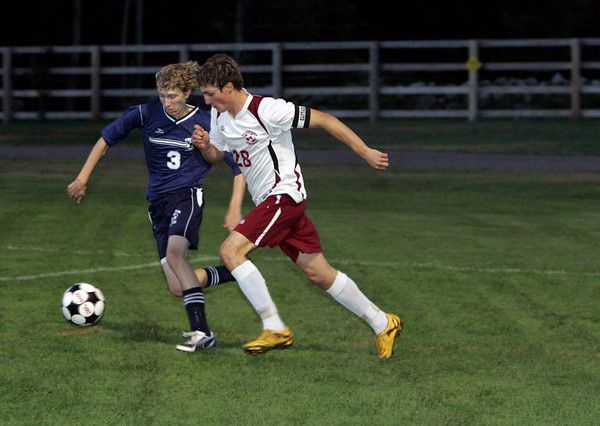 Rockport: Rockport's Andrew Burnham, right, fights for possession of the ball with Triton's Walter Scheuer during the soccer game at Rockport High School Wednesday night. Mary Muckenhoupt/Gloucester Daily Times