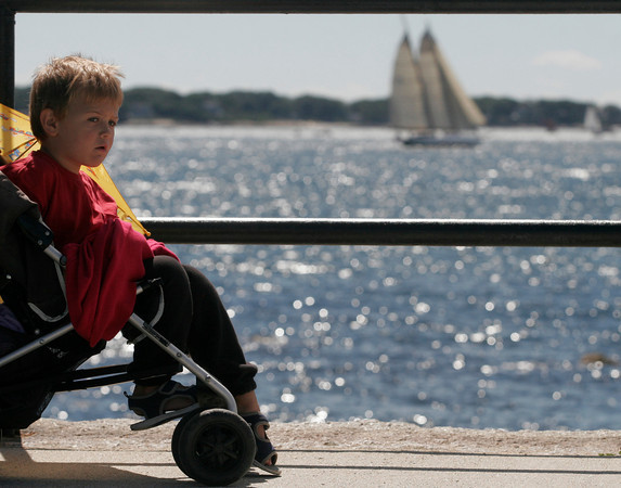 Gloucester: Charlie Jasper Blake, 3, of Saratoga Springs, NY, gets a good view of the schooners during the Parade of Sail yesterday morning as part of the 26th Annual Gloucester Schooner Festival. Photo by Kate Glass/Gloucester Daily Times