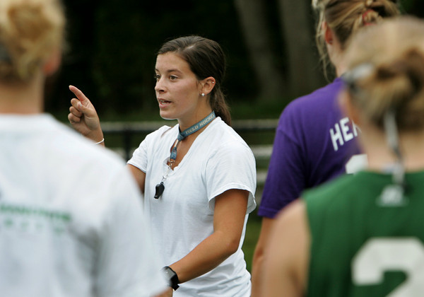 Manchester: Manchester Essex varsity field hockey coach Andrea Slaven talks to her team during practice at Ed Field Field Friday afternoon. Slaven was a standout collegiate player at Saint Michael's College and will try to continue the dominance of the Hornets field hockey team in her first year as coach. Mary Muckenhoupt/Gloucester Daily Times