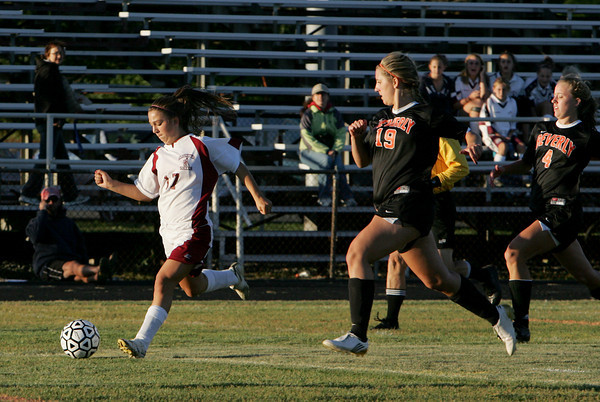 Gloucester: Gloucester's Bianca Giacalone moves the ball down the field ahead of Beverly's Alex Berking during the soccer game at Newell Stadium Wednesday evening. Giacalone scored the first goal of the game for Gloucester. Mary Muckenhoupt/Gloucester Daily Times