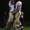 Winthrop: Gloucester's Brandon Cusumano and Gilbert Brown leap in the air as they celebrate Cusumano's touchdown in the first quarter of their game against Winthrop last night. Photo by Kate Glass/Gloucester Daily Times