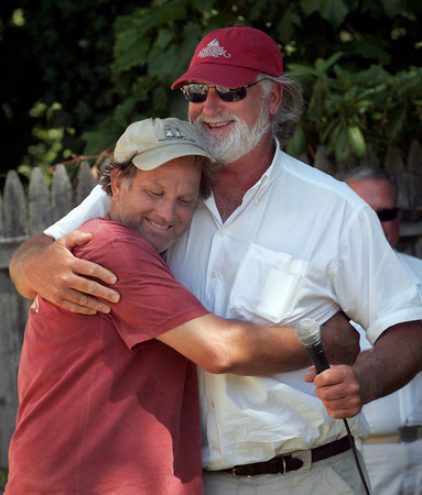Essex: Harold Burnham hugs Captain Tom Ellis of the schooner Thomas E. Lannon during a ceremony for the framing of the Pinky Schooner Ardelle at the Essex Shipbuilding Museum and H.A. Burnham Boat Building yesterday. The schooner build will be ongoing throughout the year. Photo by Kate Glass/Gloucester Daily Times