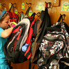 Essex: Isabella Thurlow gets a snack from her backpack during her first day of first grade at Essex Elementary School yesterday. Photo by Kate Glass/Gloucester Daily Times
