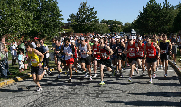 Gloucester: Hundreds of runners head out from O'Maley Middle School for the 77th Around Cape Ann 25K Road Race yesterday morning. Photo by Kate Glass/Gloucester Daily Times