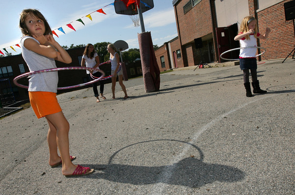 Rockport: Julia Moceri, left, and Molly Ambrose won the hula hoop contest at the Rockport Public School's block party on Sunday. The two kept the hula hoops spinning long after the contest was over. Photo by Kate Glass/Gloucester Daily Times