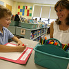 Rockport: Colin Porter smiles at his mom, Mary Porter, as he draws a picture of his family during his first day of kindergarten at Rockport Elementary School on Tuesday. Photo by Kate Glass/Gloucester Daily Times