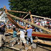 Essex: Several hundred people watch as the crew from H.A. Burnham Boat Building raises the first frame on the Pinky Schooner Ardelle during Frame Up! In the Basin at the Essex Shipbuilding Museum and H.A. Burnham Boat Building yesterday. The schooner build will be ongoing throughout the year. Photo by Kate Glass/Gloucester Daily Times