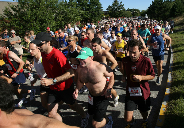 Gloucester: Hundreds of runners take off from O'Maley Middle School for the 77th Around Cape Ann 25K Road Race yesterday morning. Photo by Kate Glass/Gloucester Daily Times