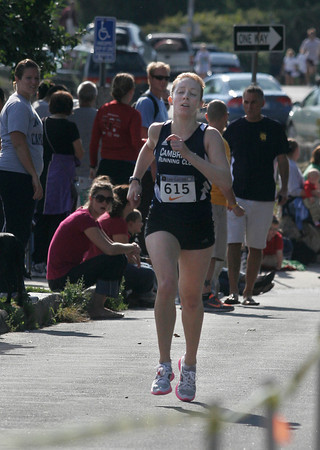 Gloucester: Kaitlin Anelauskas of Cambridge is the first female to cross the finish line of the 4th Annual Lone Gull 10K Road Race yesterday morning with a time of 37:07. Photo by Kate Glass/Gloucester Daily Times