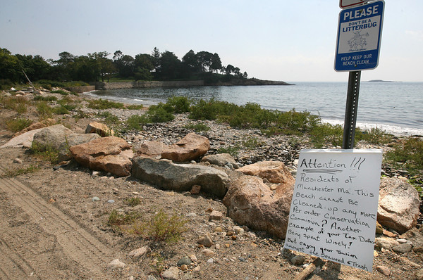 Manchester: A Manchester resident posted this sign at White Beach telling residents to enjoy swimming amongst the seaweed and trash because the Conservation Commission has ordered that the beach cannot be cleaned. Photo by Kate Glass/Gloucester Daily Times