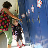 Manchester: Nicole Keating shows her son, Tyrone, his brother Finn's locker at Manchester Memorial Elementary School yesterday morning. Tyrone began pre-K yesterday. Photo by Kate Glass/Gloucester Daily Times