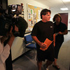 Gloucester: Television crews wait for Mick Lafata, owner of the Charter School building, to have one last document signed by the city's building inspector  giving the city's go-ahead to open the Gloucester Charter School Wednesday at the City Hall Annex on Pond Road afternoon.  The school is now set to open Thursday morning. Also pictured is Ruthie Exama, parent of a charter school student. Mary Muckenhoupt/Gloucester Daily Times