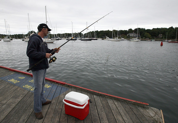Manchester: Peter Sullivan checks his line to discover his bait is missing while fishing off Tuck's Point yesterday afternoon. Sullivan says he hasn't caught a fish all summer and wasn't having any luck yesterday. Photo by Kate Glass/Gloucester Daily Times