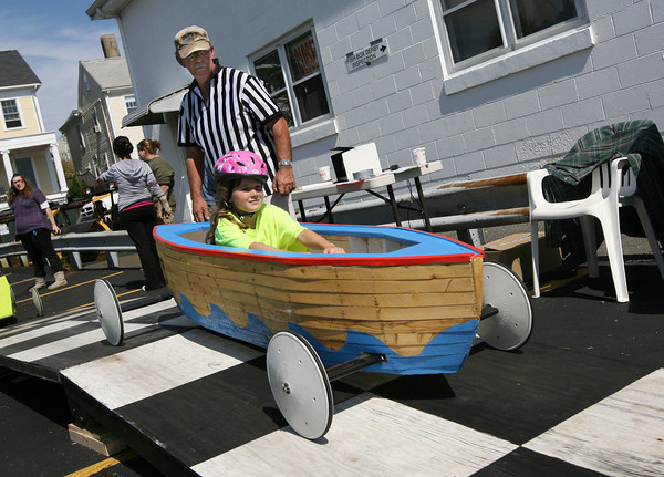 Gloucester: Sara Wheeler drives her car off the ramp after being weighed by Bob Ryan during the Fish Box Derby on Rogers Street yesterday. Photo by Kate Glass/Gloucester Daily Times