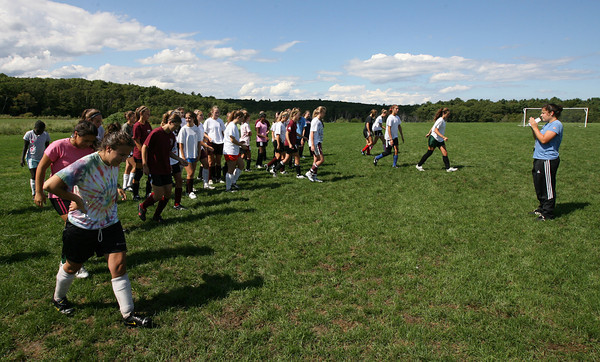 Gloucester: Coach Alex White gathers members of the Gloucester High School girls soccer team during a practice at Magnolia Woods. Photo by Kate Glass/Gloucester Daily Times