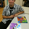 Gloucester: Jason Burroughs, one of several teen artists selling work at the Cape Ann Farmers Market through the Teen Artist Guild. The program is a collaboration between Cape Ann Art Haven and the Cape Ann Business Incubator. Photo by Kate Glass/Gloucester Daily Times