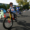 Manchester: John Kilgour of Ipswich and Gus Hawley of Manchester hop on their bikes as they leave the transition area during the Manchester Athletic Club Youth Triathlon on Sunday. The event featured three different races for kids age 5-6, 7-10, and 11-14. Photo by Kate Glass/Gloucester Daily Times