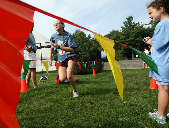 Manchester: Helen Chase crosses the finish line of the Manchester Athletic Club Youth Triathlon on Sunday. The event featured three different races for kids age 5-6, 7-10, and 11-14. Photo by Kate Glass/Gloucester Daily Times