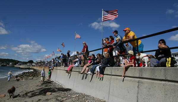 Gloucester: Hundreds of people gathered on Stacy Boulevard to watch the Parade of Sail, part of the 26th Annual Schooner Festival, yesterday morning. Photo by Kate Glass/Gloucester Daily Times