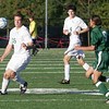 Manchester: Manchester Essex's Adam Jackson traps the ball as Cathedral's Alex Castillo charges during their game at Hyland Field yesterday afternoon. Photo by Kate Glass/Gloucester Daily Times