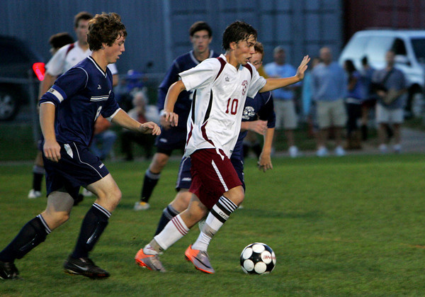Rockport: Rockport's Shaffy Roell keeps the ball ahead of Triton defenders during the soccer game at Rockport High School Wednesday night. Mary Muckenhoupt/Gloucester Daily Times