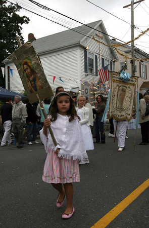 Gloucester: Bailey Saputo marches in the Mother of Grace Club Parade down Washington Street on Sunday, the final day of their annual fiesta. Photo by Kate Glass/Gloucester Daily Times