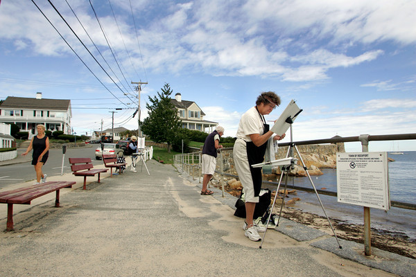 Rockport: Susan Daly works on a painting a scene of the water from Beach Street in Rockport Thursday morning.  Daly, who has been painting all her life, was quickly painting the rocks in the water that were disapperaing with the high tide. Mary Muckenhoupt/Gloucester Daily Times
