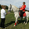 Essex: Gabriella Herrmann gives Nicky a treat after performing maneuvers with Juliana Herrmann at Cogswell's Grant yesterday. The Herrmann's Royal Lipizzan Stallions will do three shows at Cogswell's Grant this weekend. Tickets can be purchased at the gate and spectators are advised to bring their own seating. Photo by Kate Glass/Gloucester Daily Times