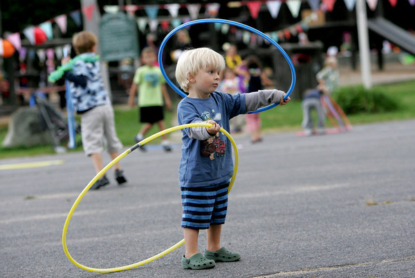 Essex: Joshua Smith, 3, tries his best at the hula hoop while playing at the hula themed party held to celebrate the new school year behind Essex Elementary School Friday evening.  Mary Muckenhoupt/Gloucester Daily Times