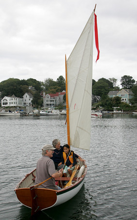 Gloucester: Roger Garberg and his wife Mern Sibley take their daughter Lucy, 8, out for a sail from Rocky Neck as a fun after school activity Friday afternoon.  Mary Muckenhoupt/Gloucester Daily Times