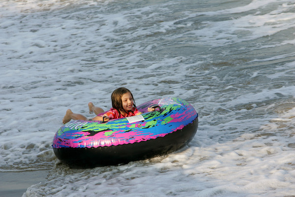 Rockport: Bridget Johnson, 6, rides a wave into shore while enjoying one of the last summer days at Long Beach late Wednesday afternoon. Mary Muckenhoupt/Gloucester Daily Times