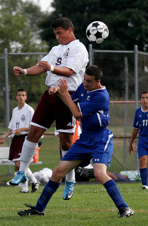 Gloucester: Gloucester's Paulo Lopes leaps above Methuen's Jimmy Summa during their game at Newell Stadium yesterday. Photo by Kate Glass/Gloucester Daily Times