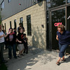 Gloucester: Ruthie Exama runs out to greet parents and students with Mick Lafata, owner of the Charter School building, after the building inspector signed a permit giving the city's go-ahead to open the Gloucester Charter School Wednesday afternoon.  The school is now set to open Thursday morning. Mary Muckenhoupt/Gloucester Daily Times