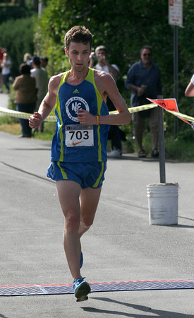 Gloucester: Nate Krah of Boston crosses the finish line of the 4th Annual Lone Gull 10K Road Race with the winning time of 31:22 yesterday morning. Photo by Kate Glass/Gloucester Daily Times