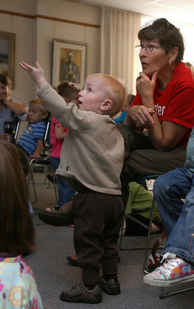 Rockport: Henry Hotz points to the video screen as the movie starts while attending story hour at the Rockport Public Library with his grandmother, June Carlson, on Tuesday morning. The story hour, which is for children age 3-5, features several stories and a short film every Tuesday at 10 am. Photo by Kate Glass/Gloucester Daily Times