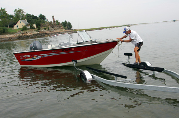 Essex: Dave Griggs takes his boat out of the water just in case hurricane Earl ends up being a damaging storm at Conomo Point Friday morning. Griggs said that he had such a great summer out on the boat with the all the sunny weather that he doesn't mind pulling the boat out a bit early. Mary Muckenhoupt/Gloucester Daily Times