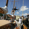 Gloucester: P.J. Connolly lowers down from running a halyard on the main mast of the Summerwind docked behind the Maritime Heritage Center Saturday afternoon. The Summerwind, a teaching vessel for the U.S. Merchant Marine Academy, was in Gloucester this weekend for the Schooner Festival. Mary Muckenhoupt/Gloucester Daily Times