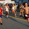 Gloucester: Tony Petrilli of Magnolia leads the Magnolia Fun Run and never looked back as he was the first to cross the finish line on Thursday evening. Petrilli ran the 5k race 20 minutes later. Photo by Kate Glass/Gloucester Daily Times