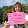 Manchester: Manchester Essex senior Rachel Jones holds a placard for students who park their cars on the street near Manchester Essex High School.  Thre is parking available in the lot for $70 offered to seniors first then juniors. Mary Muckenhoupt/Gloucester Daily Times