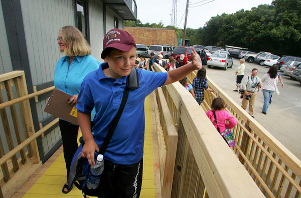 Gloucester: Fifth grader Ryker Bos waves to his mother before heading to his classroom for the first day of school at the new Gloucester Charter School Thursday morning. The school opened nearly four weeks late. Mary Muckenhoupt/Gloucester Daily Times