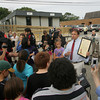 Gloucester: Tony Blackman, the executive director of the Gloucester Community Arts Charter School, holds up the charter while holding a morning meeting before school Thursday morning. After nearly four weeks of uncertainty the school was finally able to open Thursday. Mary Muckenhoupt/Gloucester Daily Times