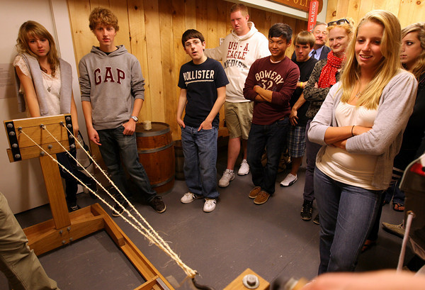 Gloucester: Gloucester High School students and exchange students from Switzerland watch a rope-making demonstration at the Gloucester Maritime Heritage Center yesterday afternoon. Fifteen students from Switzerland arrived on Cape Ann Sunday night and will be staying with Gloucester host families until October 1st. Students from Gloucester will be traveling to Switzerland in the spring. Photo by Kate Glass/Gloucester Daily Times