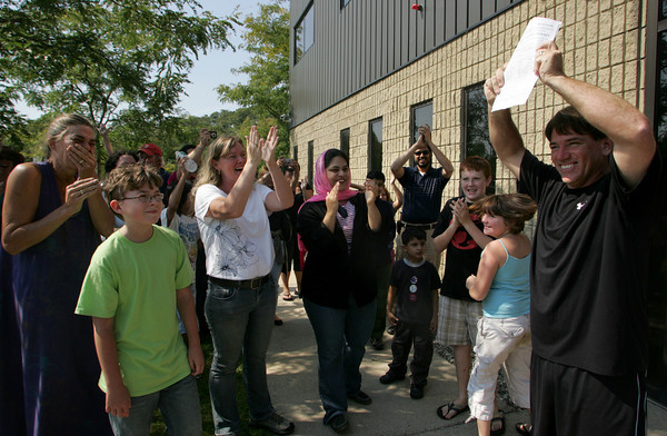 Gloucester: Mick Lafata, owner of the Charter School building, cheers with parents and students after the last document was signed by the city's buildng inspector allowing the Charter School to open Thursday morning at 8:30 a.m. Mary Muckenhoupt/Gloucester Daily Times