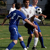 Gloucester: Gloucester's Marcos Rodrigues keeps the ball away from Methuen's Leo Cassanelli and Lane Nickerson during the first game of the season at Newell Stadium yesterday. Photo by Kate Glass/Gloucester Daily Times