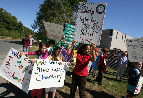 Gloucester: Emma Allen, Joscelyn Schulman, and Alexis Exama cheer during a rally at the Blackburn site of the Gloucester Community Arts Charter School yesterday in support of the school opening. Photo by Kate Glass/Gloucester Daily Times
