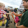 Gloucester: Mason Baxter, 18 months, touches a creamsicle corn snake held by Nathan Mineo of the Cape Ann Vernal Pond Team during the Cape Ann Farmers Market on Thursday afternoon. Photo by Kate Glass/Gloucester Daily Times
