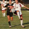 Gloucester: Gloucester's Kali Cook fights for possession of the ball with Beverly's Taylor Manzi during the soccer game at Newell Stadium Wednesday night. Mary Muckenhoupt/Gloucester Daily Times