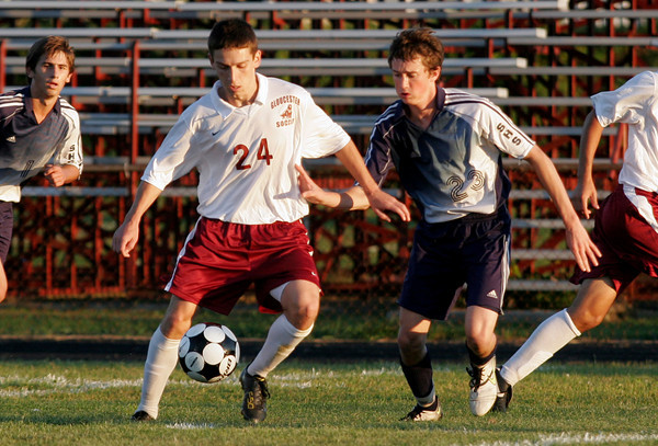 Gloucester: Gloucester's Kyle Hurd keeps the ball away from Swampscott's Chris Mason during their game at Newell Stadium last night. Photo by Kate Glass/Gloucester Daily Times