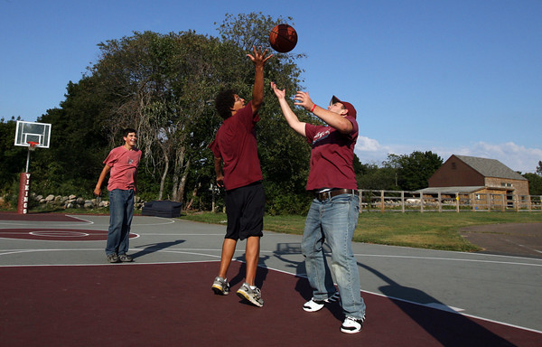 Rockport: Zak Kennedy, left, Steffen Hartwell, center, and Mark Foote, play basketball on the court behind Rockport High School on Monday afternoon. Photo by Kate Glass/Gloucester Daily Times